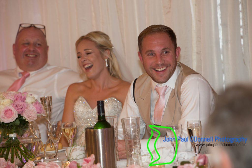 Groom and the bride taken at the top table at mulberry house onger essex