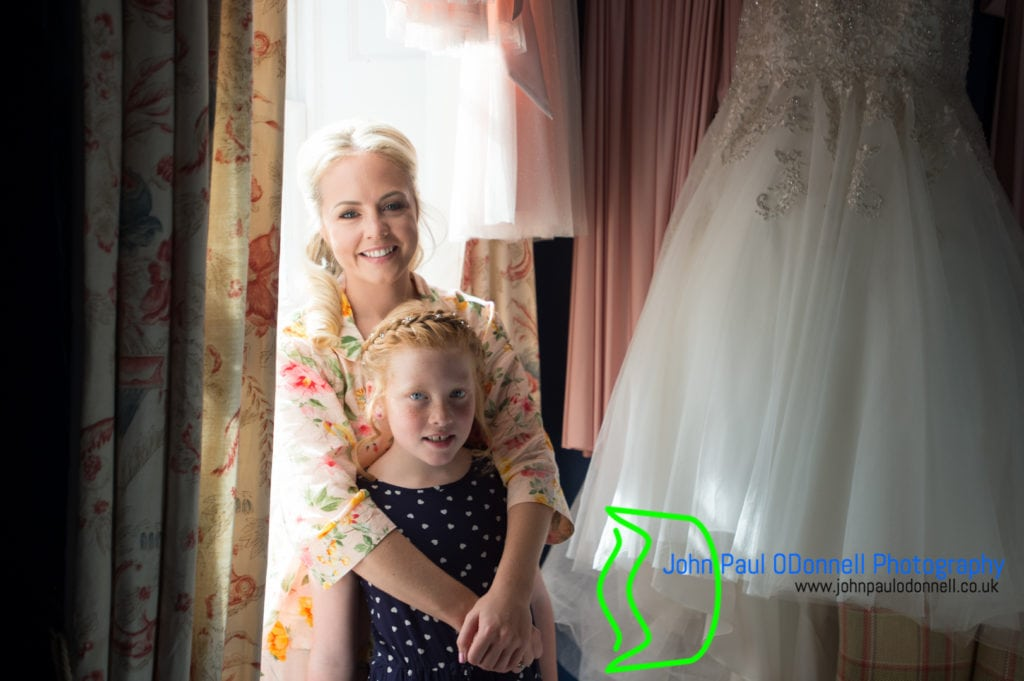Bride and her little bridesmaid in the bridal suite at mulberry house