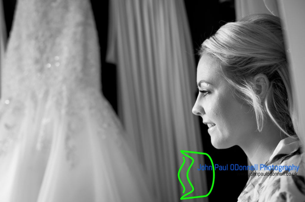 Bride in black and white by her dress at mulberry house