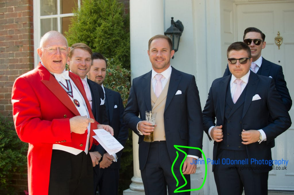 Groom and groomsmen with the toastmaster at mulberry house