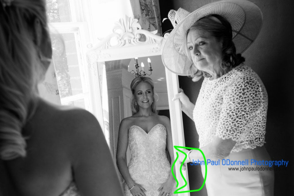 Bride and mum by the mirror in the bridal suite at mulberry house