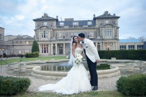 Bride and groom outside Down Hall in Essex