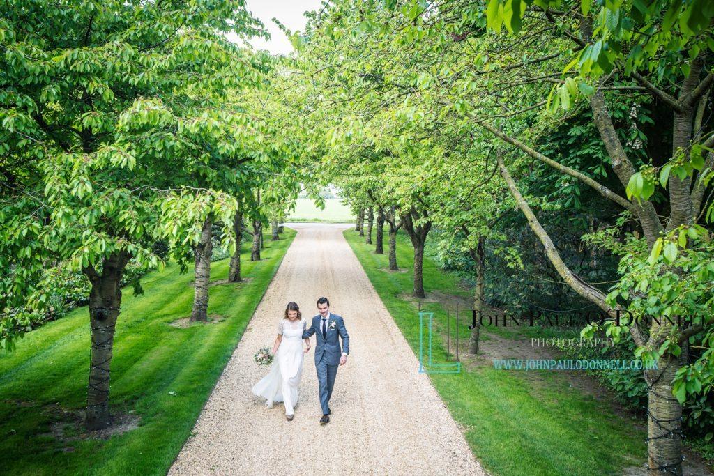 happy couple  at south farm entrance